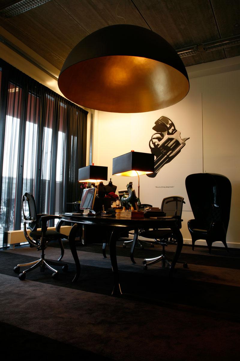The Art Of living Dangerously. Visual with gun, kantoor vanbrussel Amsterdam.
